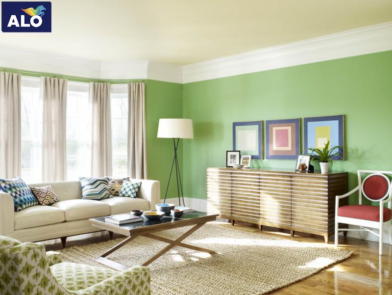 Phòng khách sử dụng gam màu xanh lá tạo không gian mát mẻ cho căn nhà